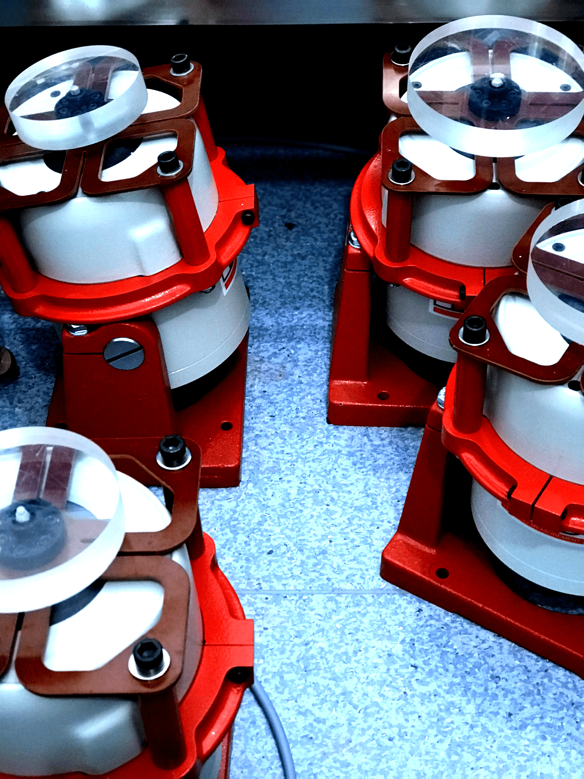 Closeup of four red vibrotactile foot shakers