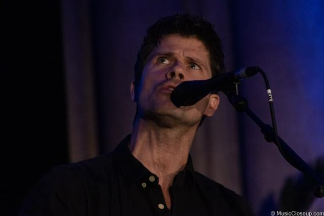 Seth Lakeman singing and glancing upwards