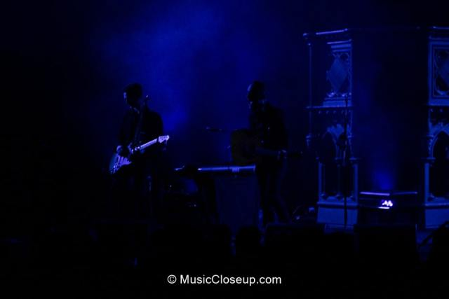 Dave and Tim Hause in silhouette shrouded in blue light