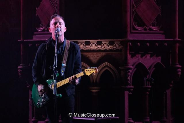 Dave Hause playing a green electric guitar