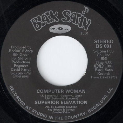 Superior Elevation - Computer Woman (7'' Black Satin # BS 001)