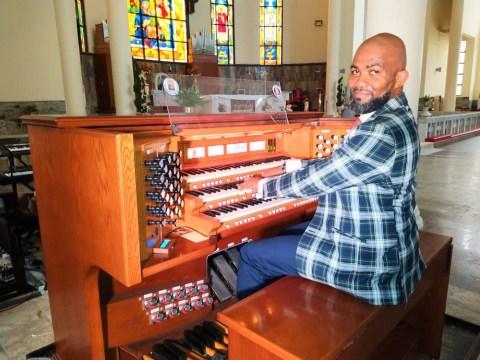 Shosanya Babatunde playing organ
