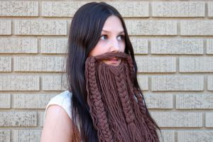 Woman wearing knitted beard - one way to be inclusive?