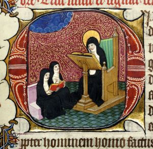 Nun reading from lectern