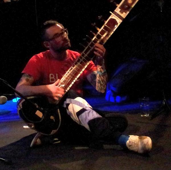 Alex Freeman playing sitar with Rhett Barrow