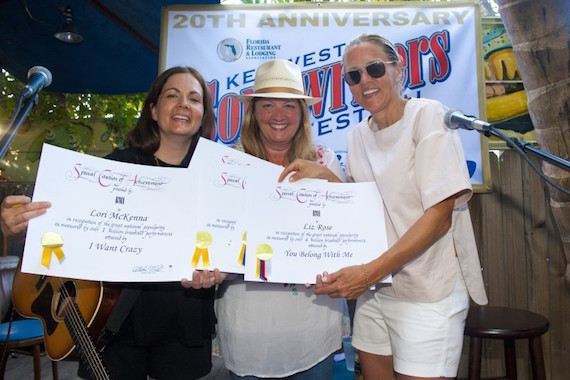 Pictured: Lori McKenna and Liz Rose receive certificates of achievement for 1 million plus broadcast performances from BMI's Leslie Roberts at Blue Heaven during the Key West Songwriter's Festival on May 7, 2015, in Key West, FL. Photo: Erika Goldring.