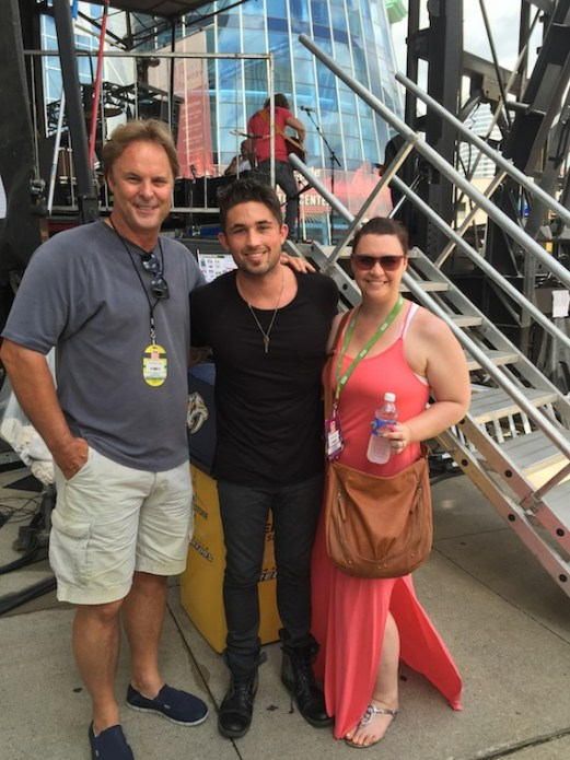 """Atlantic Records artist Michael Ray brought his Top 15 and climbing debut single, """"Kiss You In The Morning,"""" to sunbathed crowd at the CMA Music Festival. Following his performance yesterday on the Bud Light Stage at Bridgestone Arena, Ray visited with fans, friends and family. Photo from left to right – Scott Hendricks, Ray's producer and EVP A&R Warner Music Nashville; Ray and Rebekah Gordon, Director A&R, WMN"""