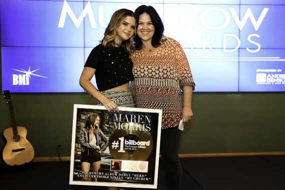 Big Yellow Dog's Carla Wallace (R) surprises her writer Maren Morris (L) with a plaque commemorating a No. 1 country album debut, along with its lead single achieving gold. Photo: Moments By Moser Photography