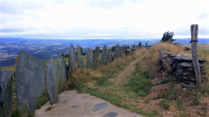 Stone fenceline along the path