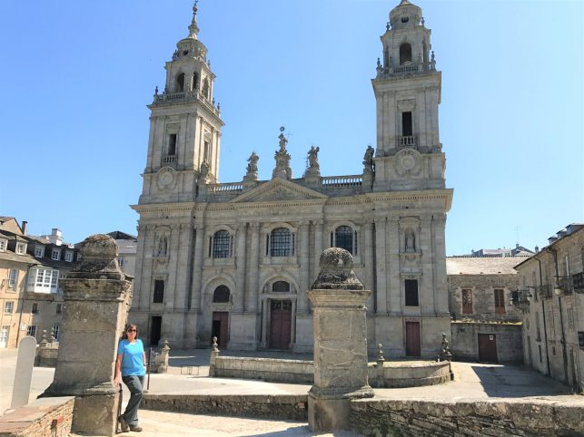 Irene standing near the Santiago gate with the Lugo Cathedral in the background