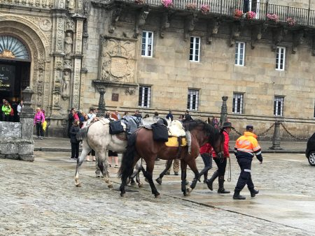 Pilgrims arriving on horseback