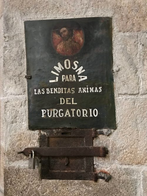 An ancient donation box for prayers to the souls in purgatory