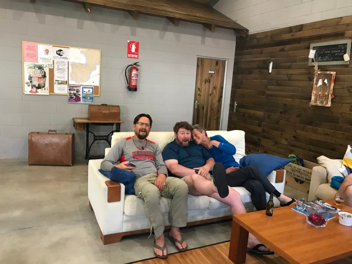 Relaxing in the common area of A Nave Albergue with a couple of the Utah folks
