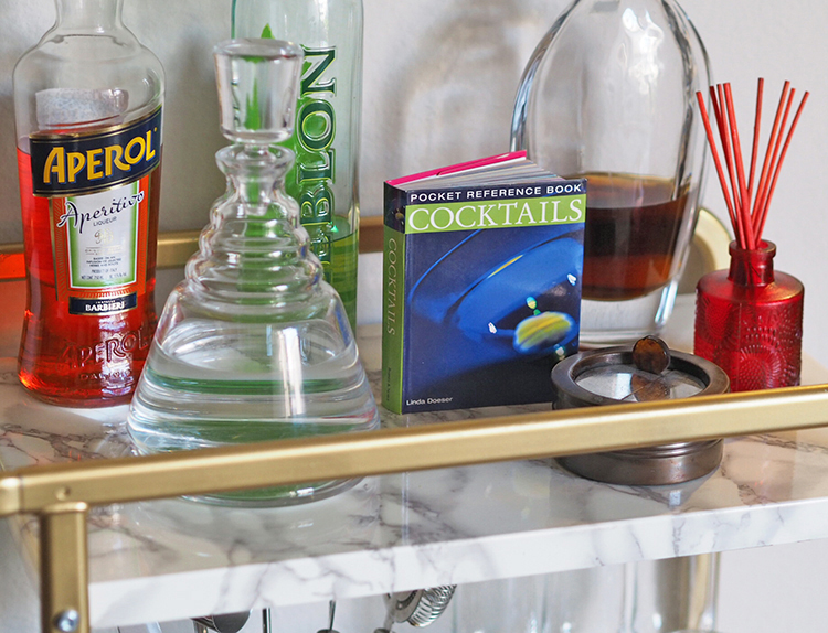 Looking for a way to infuse affordable style into your home? This IKEA Sunnersta DIY Bar Cart is the perfect solution to your style and storage woes.