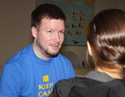MCC's Matt Grulke helps a student in the Tutoring Center