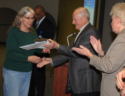 Janice Whitlow receives her award for 40 years of service to Muskegon Community College.