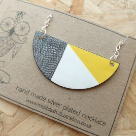 Semi Circle Yellow Necklace With Crosshatched Pattern