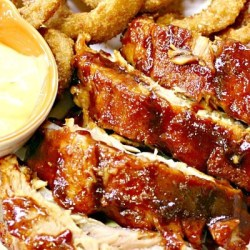 Cook up a slab of these Best Ever Oven BBQ Ribs. Restaurant quality BBQ Ribs right in your own kitchen!