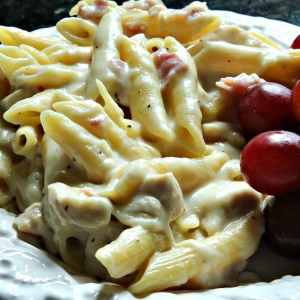 Chicken Cordon Bleu Penne Pasta is a delicious take on the old French Classic! Chicken,Ham, Swiss Cheese and Dijon combine with penne pasta to give an updated twist to this yummy dish!
