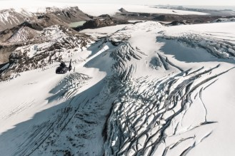 Breiðamerkurjökull is an outlet glacier of the larger glacier of Vatnajökull in southeastern Iceland. Emerging as a tongue of the Vatnajökull, it ends in a small lagoon, known as Jökulsárlón. Over time, it has gradually been breaking down