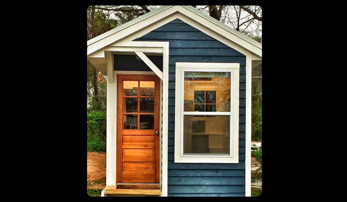 THIRTEEN-YEAR-OLD BUILDS TINY HOUSE