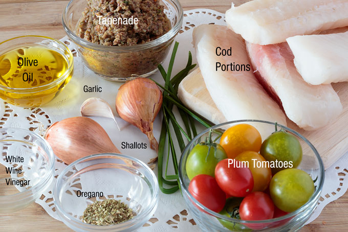 Ingredients for baked cod with tapenade and warm tomato salad