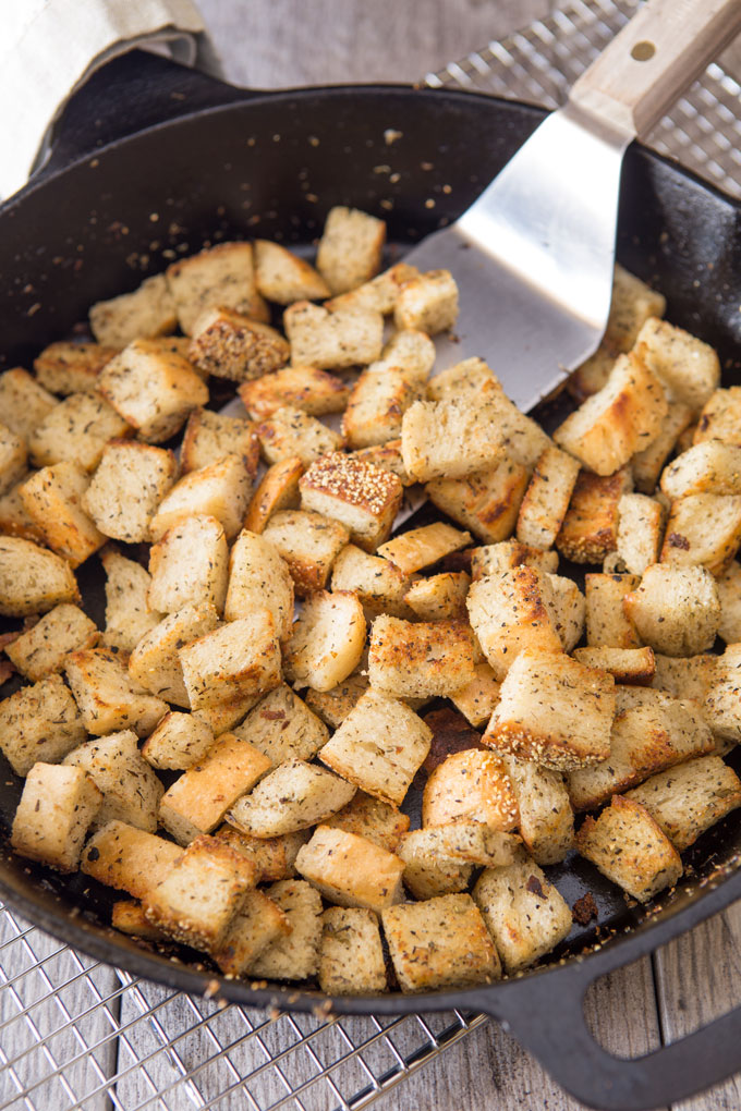 Grilled croutons cooling in the skillet on a rack