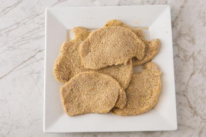 Breaded raw pork cutlets