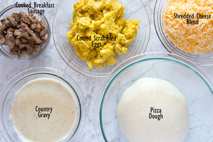 Ingredients for sausage breakfast pizza
