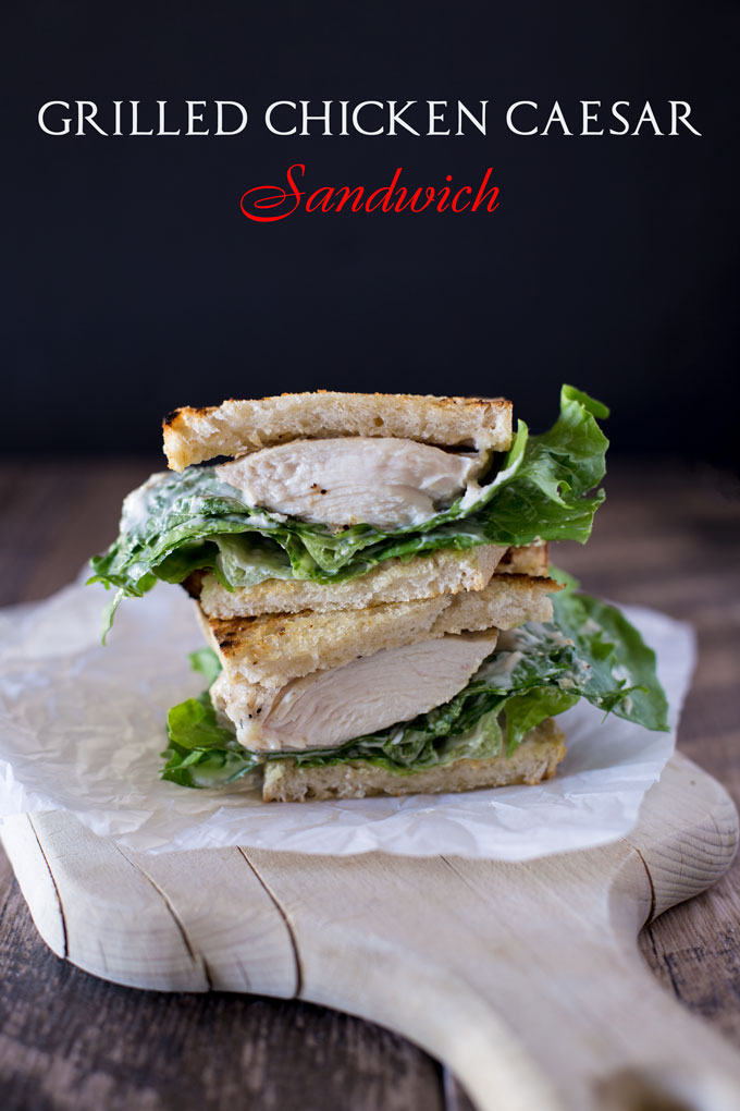 Stacked halves of the grilled chicken Caesar sandwich with text banner