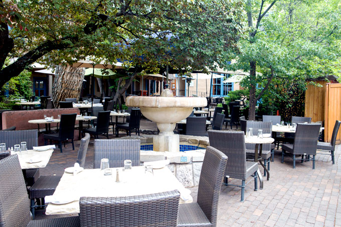 Outdoor restaurant in hacienda-style shopping area in Santa Fe