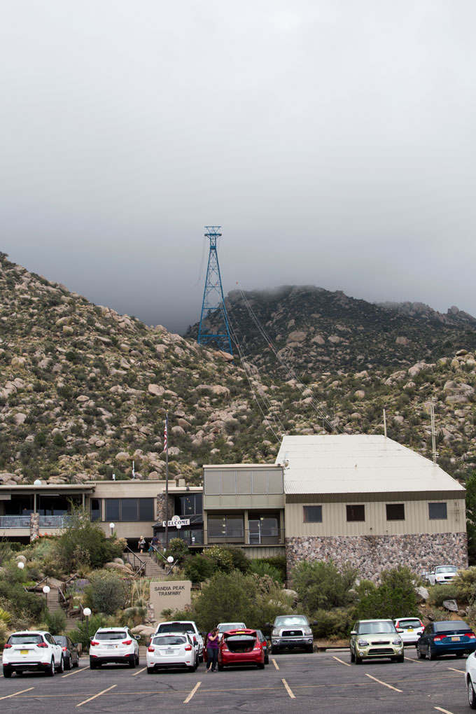 Front of tram building on Sandia Peak with towers shrouded in fog