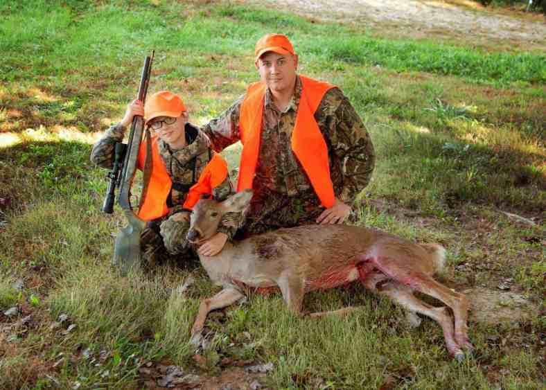 Zachary Combs with his dad Ryan and his first deer 45/385 No Excuses