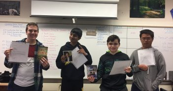 Students hold up their letters from Hosseini. Photo courtesy of Kristine Bautista.