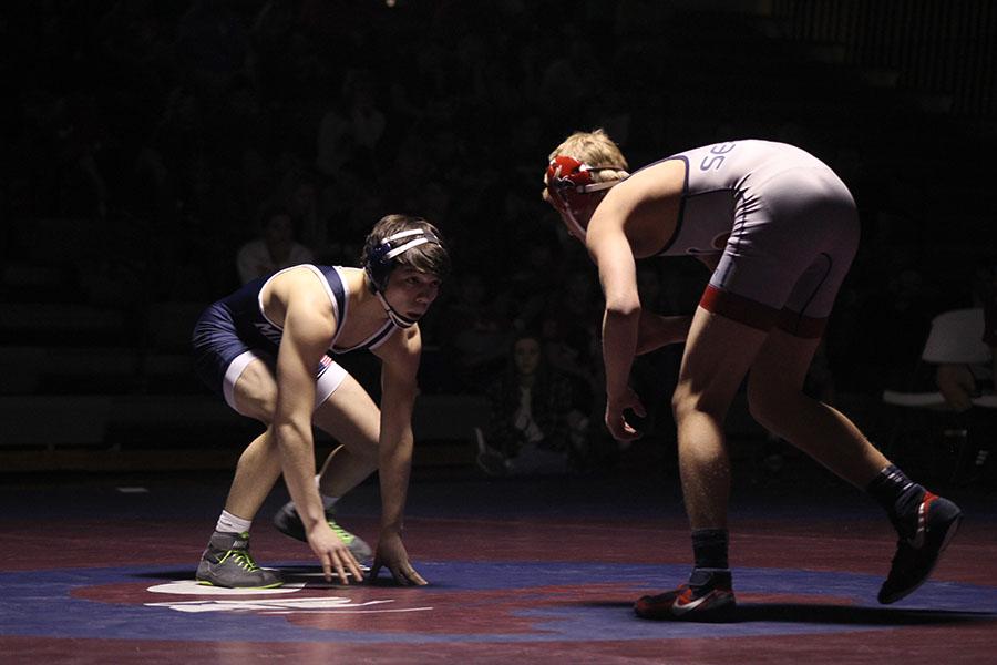 Wrestling splits in a three-team dual
