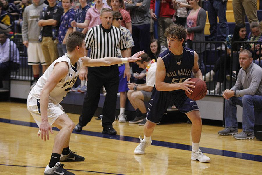 At+the+sub-state+game+against+Aquinas%2C+sophomore+Tanner+Moore+gets+ready+to+sprint+towards+the+basket.