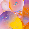 Bubbles permeate a colorful liquid.