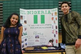 Sophomores Bri Sislo-Schutta and Colin Jones pose with their Nigeria booth