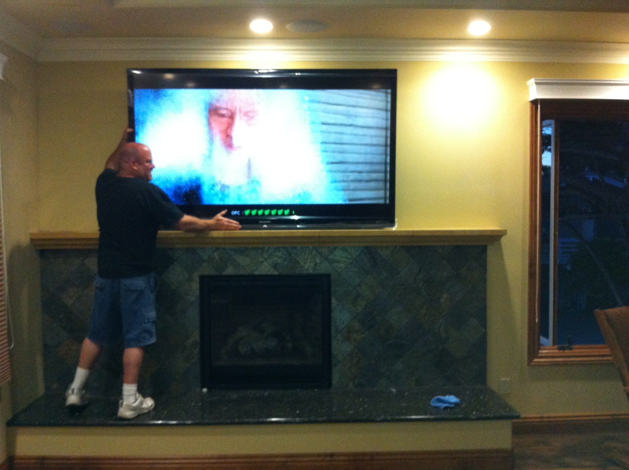 hight resolution of tv over fireplace