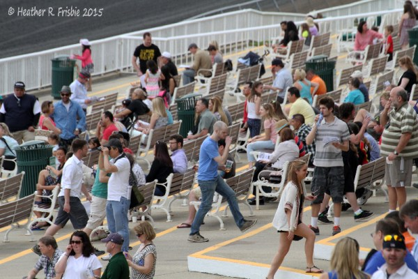 Crowd enjoying the ample bench seating on the apron