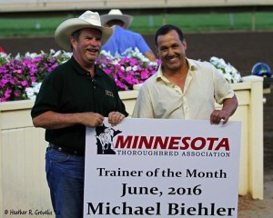Mike Biehler (R) accepts the MTA trainer of the month award from MTA president Jay Dailey.