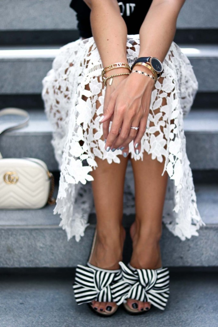 Outfit Details white lace skirt, striped slides, black and white