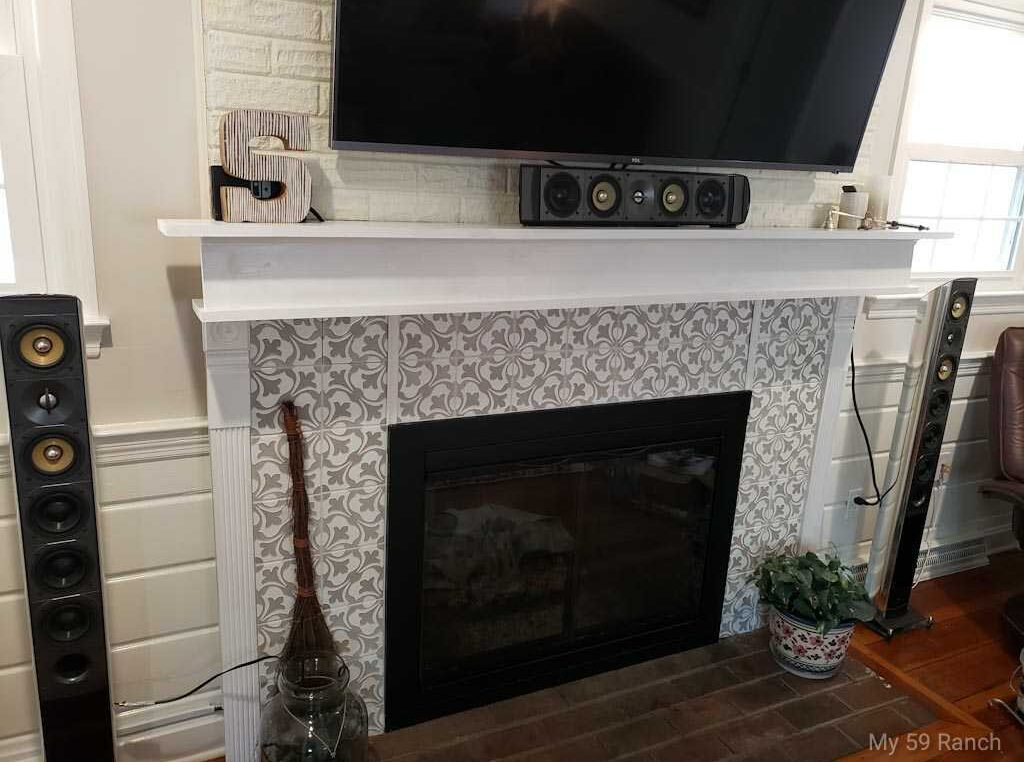 Mantle mounted on a brick fireplace