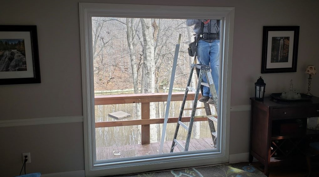 Replacement Windows large picture window by lake - exterior trim installed