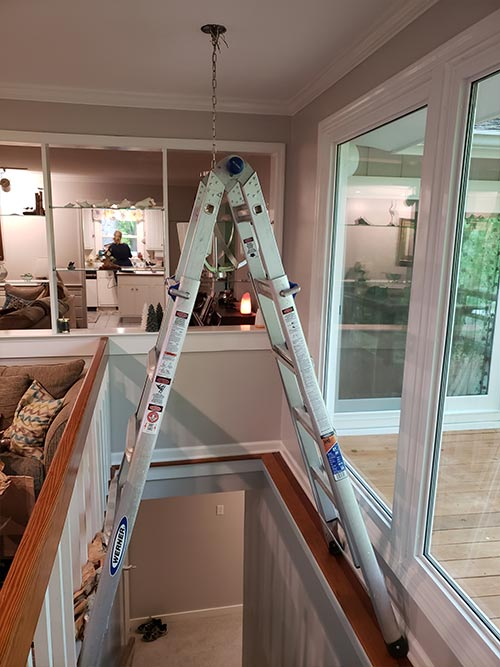 Ladder across staircase