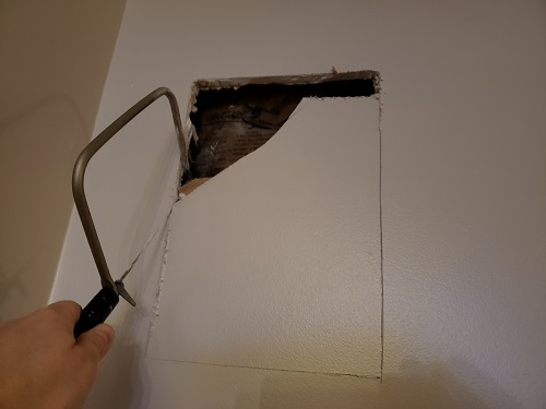 Saw to cut sheetrock for Rear Surround Sound Speakers
