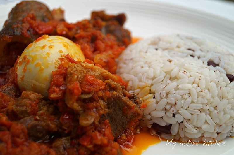 ofada rice and ofada stew on a plate