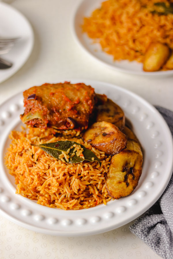 Nigerian smoky jollof rice served with peppered turkey and fried plantain.
