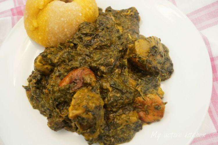 image of ofe onugbu soup with a side of eba roll