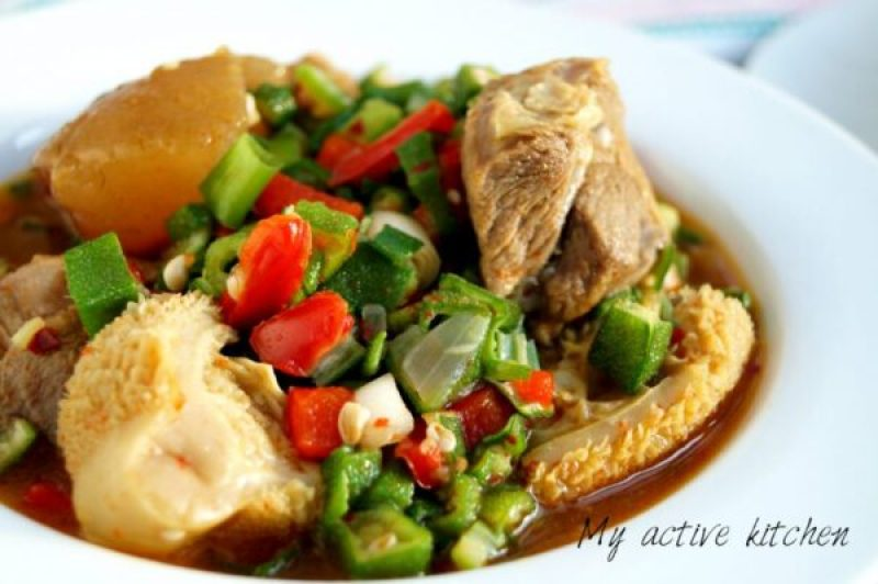 image of okra soup with assorted meat in a soup bowl
